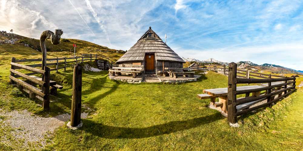Mountain cottage hut or house on idyllic hill Velika Planina. Bio Eco farming healthy life