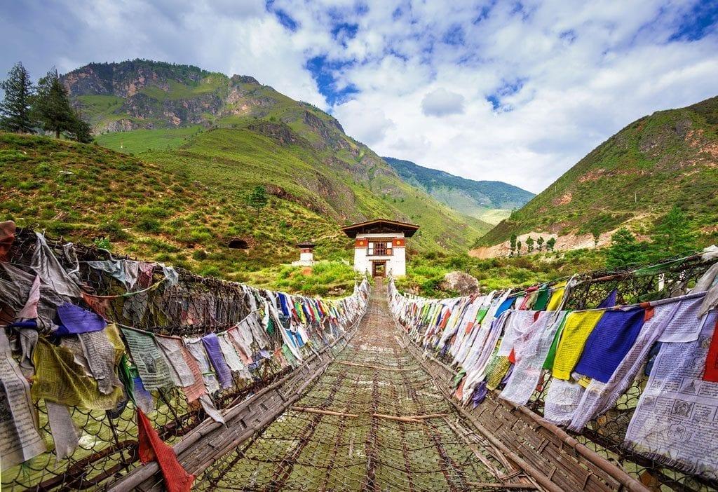Walking suspension-bridge with colourful prayer flags on the Druk Path Trek