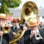 The Sussex Jazz Kings brass band perform during the Watercress Festival parade.