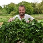 James Harper from The Watercress Company poses with watercress at the festival's Farming Zone.