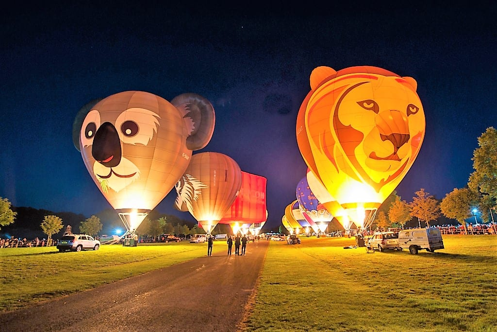 The night glow featuring Longleat's Koala and Loin hot air balloons