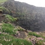 A cliff at Nólsoy with puffins nesting