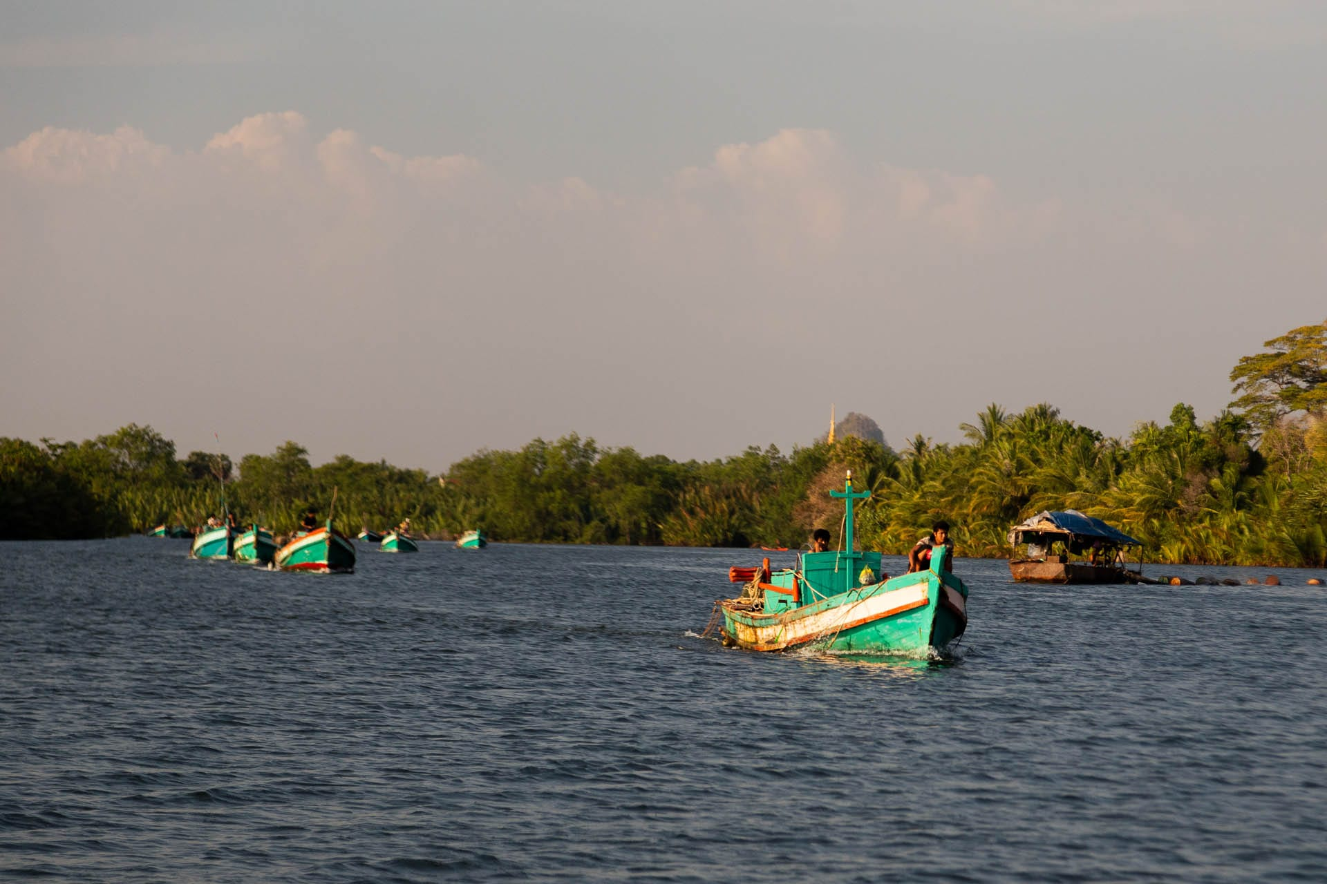 Traditional boat trip along the river at Kampot.