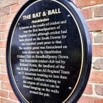 A plaque on the outside of the Bat and Ball