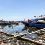 Rubbish in the water at Da Nang's fishing port