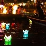 Paper lanterns float in the river