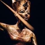 Gilded Wooden Figure of Tutankhamun on a Skiff, Throwing Harpoon - CREDIT IMG