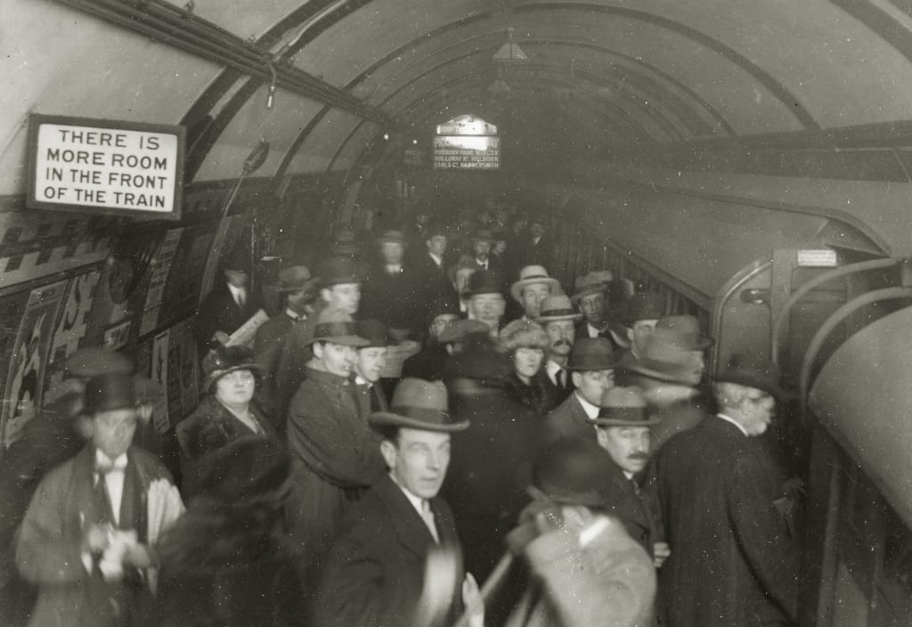 A crowded Tube platform in the rush hour at Piccadilly Circus, 1922