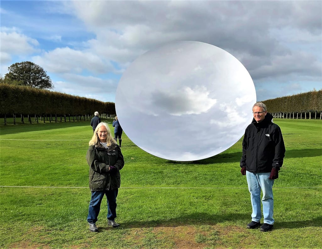 Roger and Eileen beside Anish Kapoor's Sky Mirror at Houghton Hall