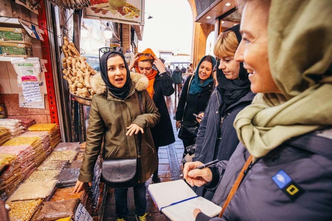 Intrepid Travel customers visit a market in Tehran, Iran