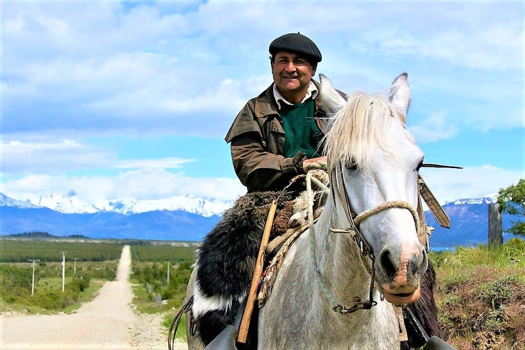 A gaucho rides along the shores of Lago General Carrera